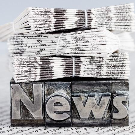 News die cut with newspapers on top