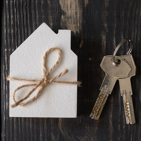 White paper cut out house with keys